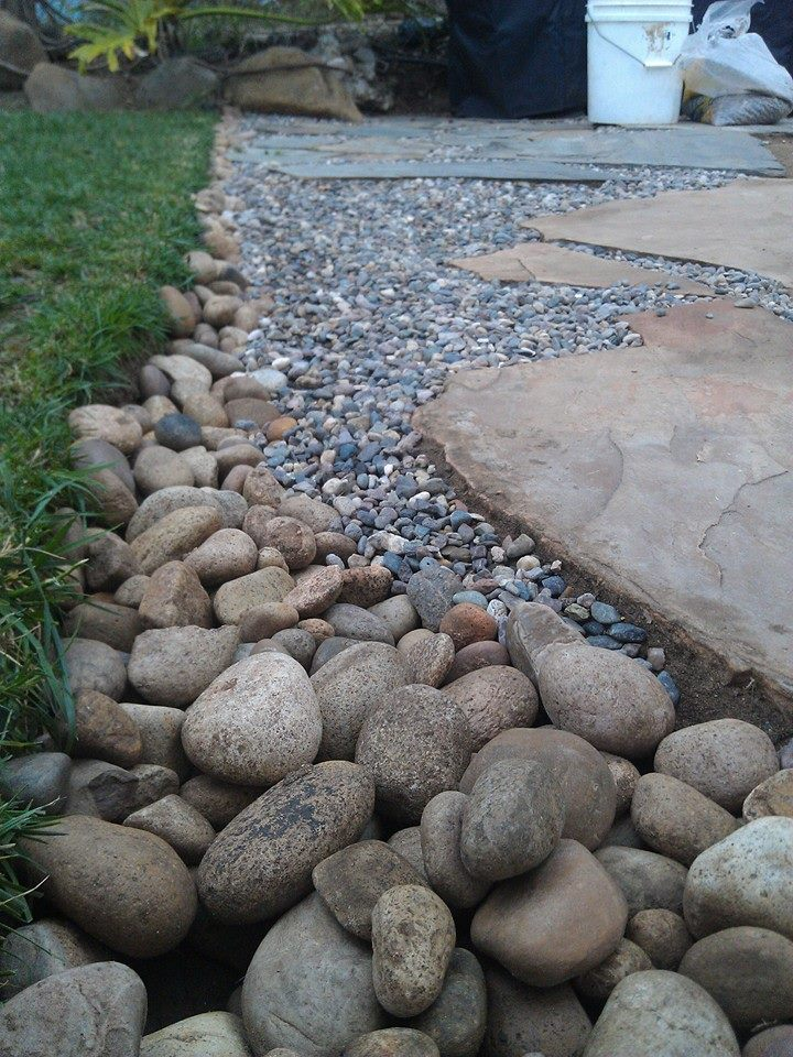 Building a flagstone patio mind your dirt for How to build a river rock patio